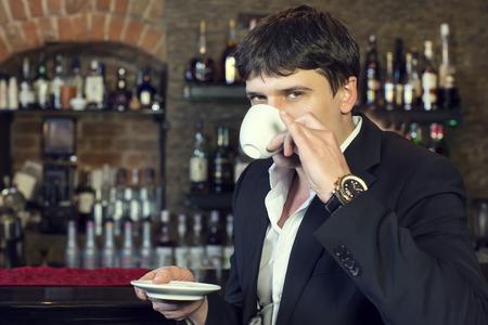 websurfing: man drinking coffee near the bar Stock Photo