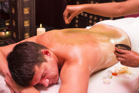 man engaged in Ayurvedic spa treatment
