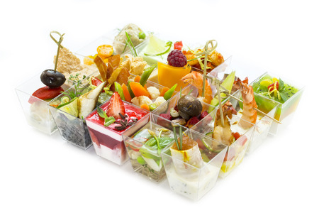 Canapes of cheese vegetables meat and seafood on white background photo