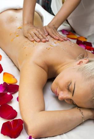 girl on procedure Balinese massage in the beauty salon photo