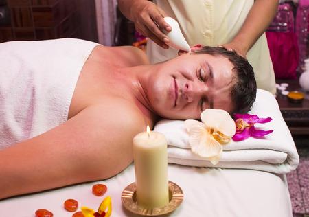 man engaged in Ayurvedic spa treatment Stock Photo