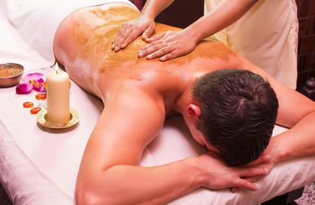 beauty treatment: man engaged in Ayurvedic spa treatment