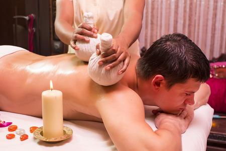man engaged in Ayurvedic spa treatment photo