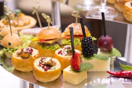 canapes: Canapes of cheese vegetables meat and seafood