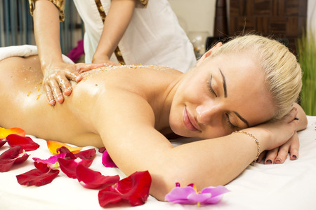 girl on procedure Balinese massage in the beauty salon photo