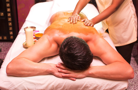 man engaged in Ayurvedic spa treatment photo