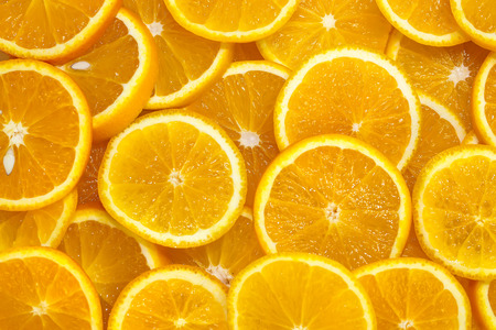 valencia orange: background of sliced oranges