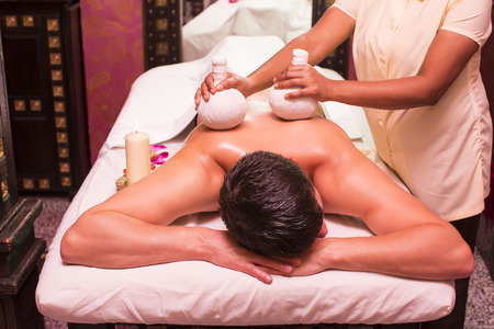 oil massage: man engaged in Ayurvedic spa treatment