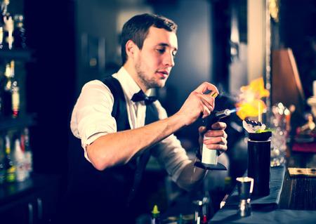 nightclub: young man working as a bartender in a nightclub bar Stock Photo