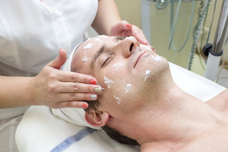 natural health and beauty: man in a beauty salon facial and massage