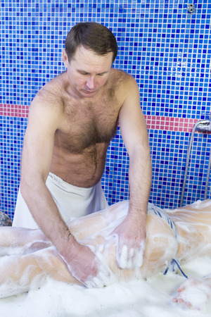 soaping: procedure wellness foam massage woman in hammam