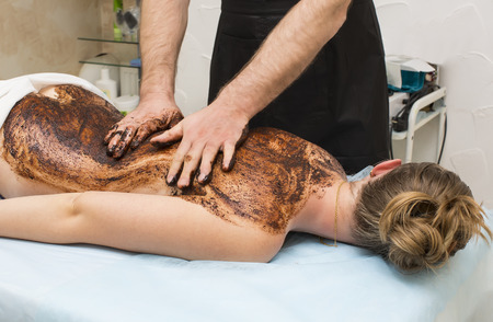coffee chocolate massage procedure Woman in a beauty salon spa photo