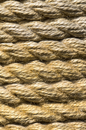braided flexible: background of hemp rope woven several levels Stock Photo