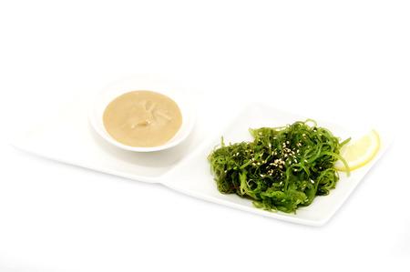 japanese cookery: salad with exotic marine algae on a white background Stock Photo