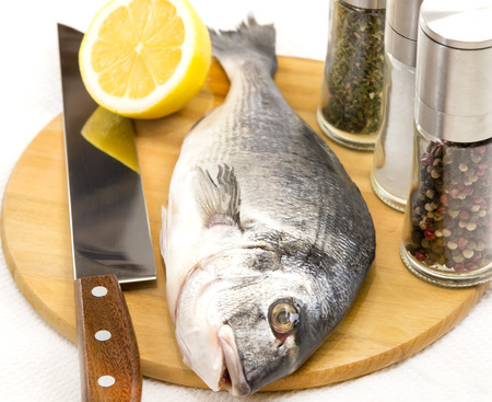 european roach: raw fish on a cutting board and knife Stock Photo