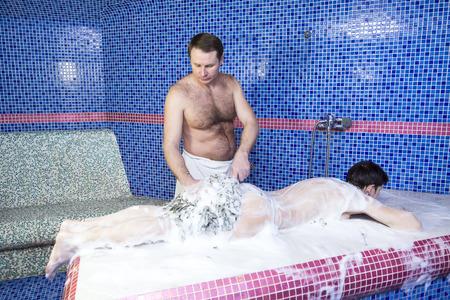 hamam: procedure wellness foam massage woman in hammam