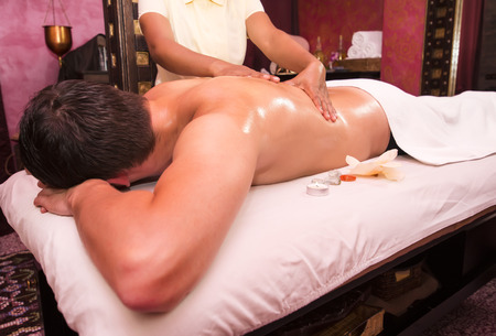 panchakarma: man engaged in Ayurvedic spa treatment