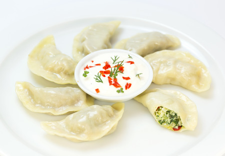 nepali: Nepalese food momo on a white background in the restaurant