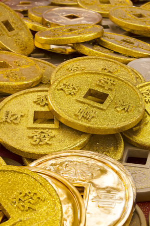 cues: Chinese coins of gold color shot close-up cues