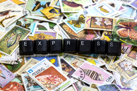 philatelic: words on cubes against the background of the old postal stamps Stock Photo