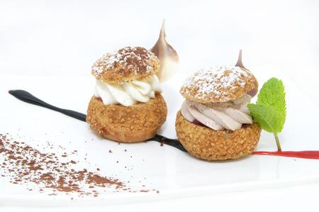 chocolate mint: profiteroles with vanilla ice cream decorated with chocolate mint Stock Photo
