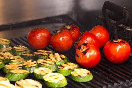 broiling: cooking vegetables on the grill in the kitchen at the restaurant