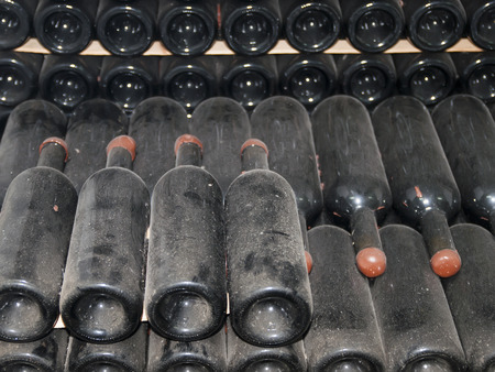 cabarnet: wine bottles stored in the old wine cellar Stock Photo