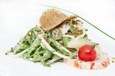 the greens: salad greens and shrimp meat on a white background Stock Photo