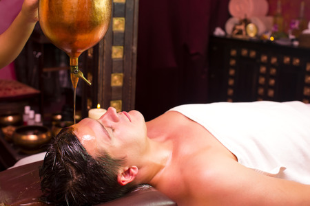 people man engaged in Ayurvedic spa treatment