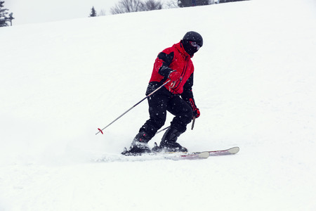 male skier on downhill a steep hill Stock Photo