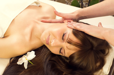 skin treatment: massage and facial peels at the salon cosmetics Stock Photo