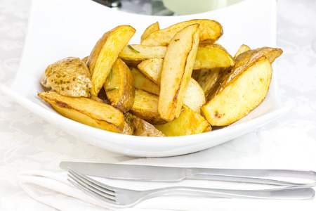 quartered: fried potatoes on a plate in a restaurant