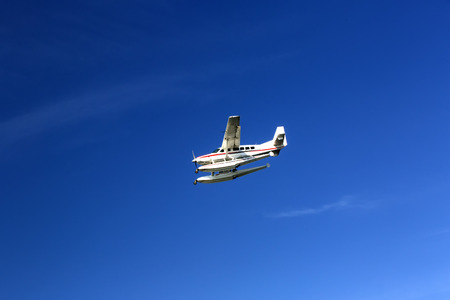 hydroplane: seaplane fly high in the blue sky Stock Photo