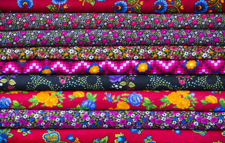 Background of the scrolls rolls colored colorful fabric photo