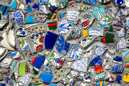 broken wall: wall with broken ceramic plates colored fragments