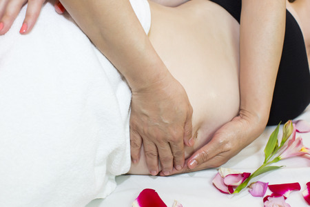 therapeutic massage: processes salon doing massage to a pregnant woman