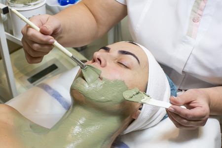 facial: massage and facial peels at the salon cosmetics Stock Photo