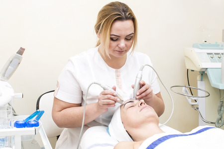 face skin: massage and facial peels at the salon cosmetics Stock Photo