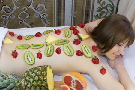 fruity young girl doing a massage in the beauty salon photo