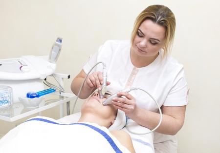 massage and facial peels at the salon cosmetics Stock Photo