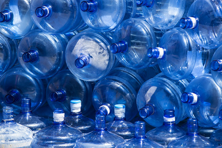 bottle with water: used plastic bottles large blue