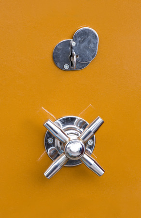 impenetrable: metal door with a safe lock and handle to open