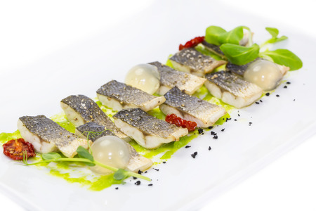 plaice: baked black cod fish on a white background in the restaurant
