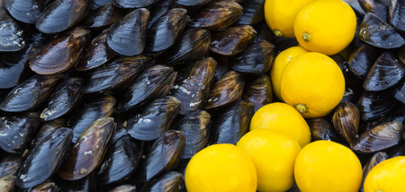 fish exhibition: mussels and lemon meal noodles on the market Stock Photo