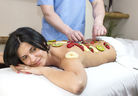 beauty salon: fruity young girl doing a massage in the beauty salon