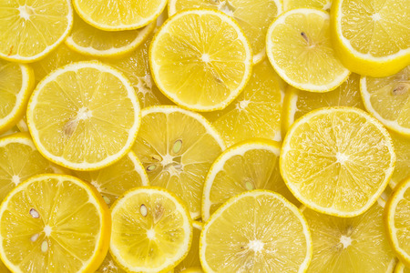 background of sliced ripe lemons organic, pattern Stock Photo