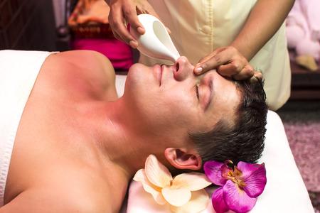 panchakarma: people man engaged in Ayurvedic spa treatment