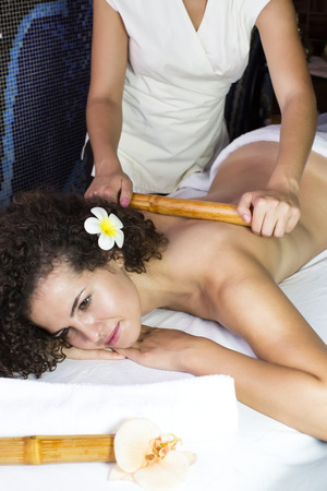 salon and spa: Japanese massage with bamboo sticks in the spa salon Stock Photo