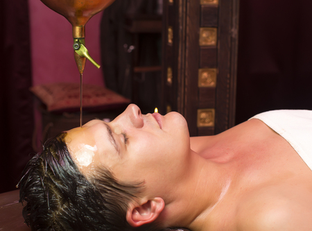 panchakarma: people man engaged in Ayurvedic spa treatment