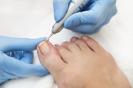 process of pedicure at beauty salon Stock Photo